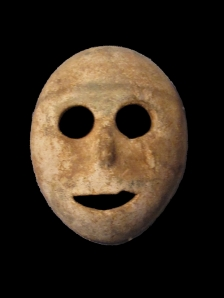 Stone mask from the Pre-Ceramic Neolithic period, 7000 BCE. Musée Bible et Terre Sainte.